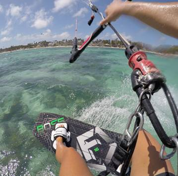 Kitesurfer riding around the clear waters of Boracay in the Philippines